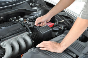 Technician checking car engine